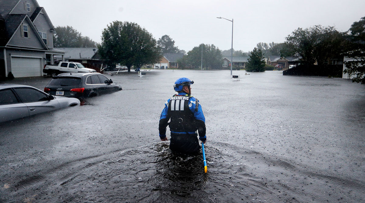 A member of the North Carolina Task Force rescue team surveys flooding in Fayetteville, N.C. on Sept. 16. (David Goldman/AP)